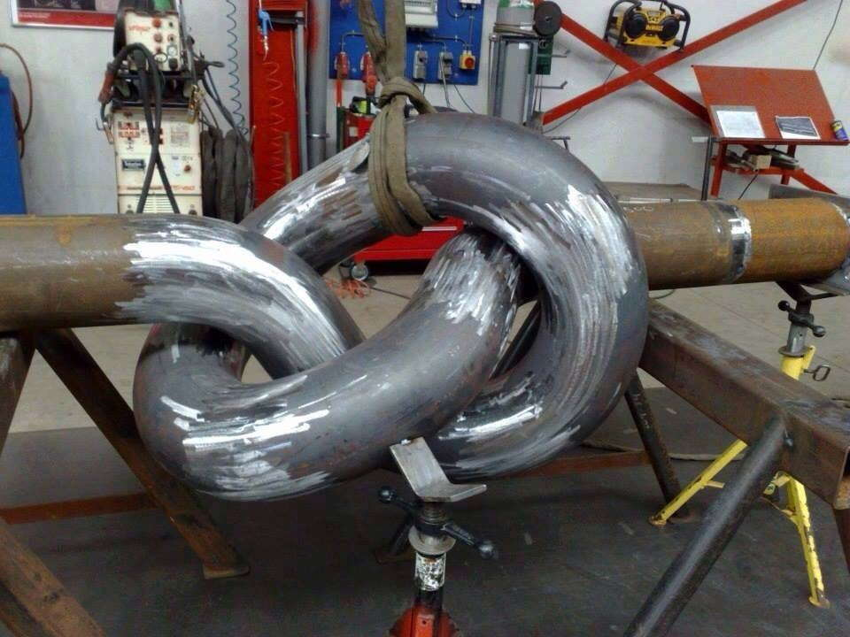 big knotted iron hose sculpture