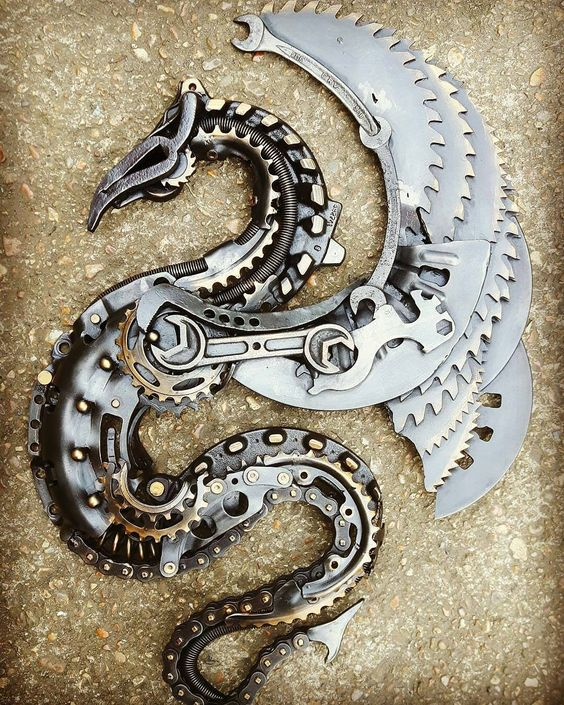 dragon with blade wings metal sculpture