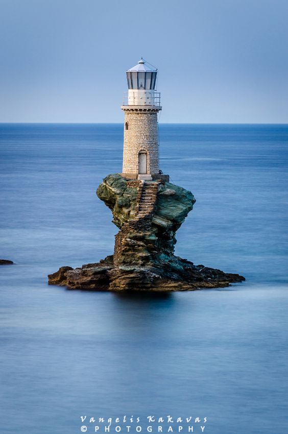 lighthouse in the middle of water