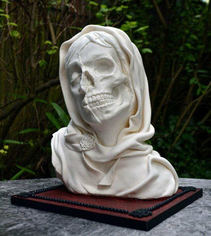 skull bust in white dress cake