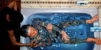 tattoos man in the bath