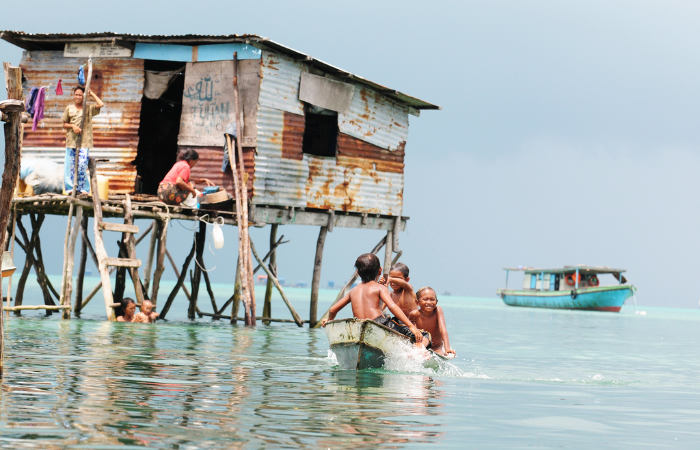 bajau laut kids on boat